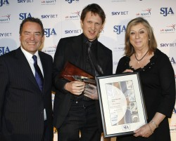 The Telegraph's Oliver Brown receives the Young Sports Writer award for 2009 from Sarah Wooldridge and Jeff Stelling