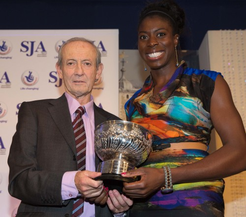Christine Ohuruogu receives the Pat Besford Trophy for outstanding performance of 2013 from Dan Topolski. The 400m runner had won this trophy previously in 2007