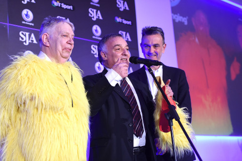 When Neil Baldwin, left, arrived on stage with Lou Macari, centre, and Peter Bowker to collect the 2014 Chairman's Award, he did so wearing a chicken suit, a first for the SJA's British Sports Awards. Photo by Tom Dulat/Getty Images)