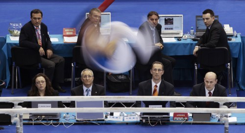 The work of Eddie Keogh from Reuters, such as this picture of judges during the European gymnastics championships, as a competitor performs a somersault, regularly featured in the SJA Sports Photography Awards