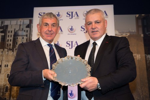 Past Team of the Year winner, as a player and as a coach, Sir Ian McGeechan presents the trophy for 2013 to his successor as British and Irish Lions coach, Warren Gatland