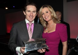 Double winner: AP AP McCoy and his wife, Chanelle, with the SJA Sportsman of the Year award in 2010. Odds-on in 2015, too?