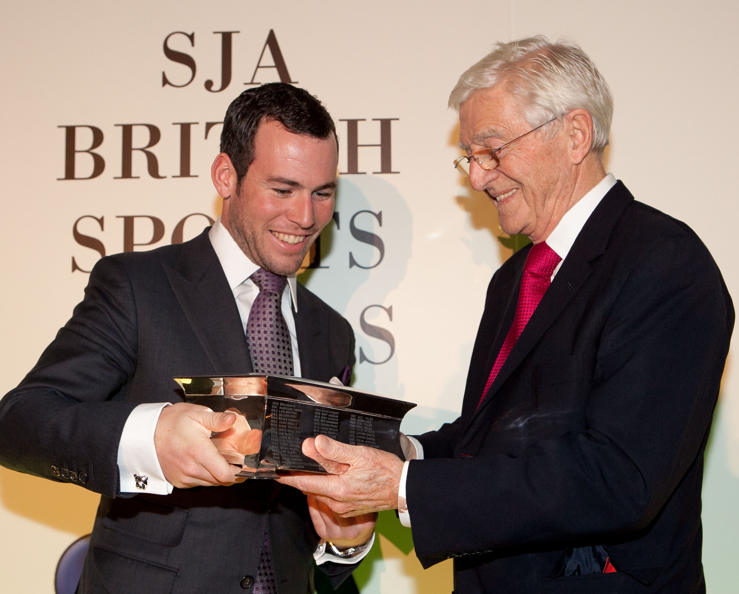 Delighted: world champion cyclist Mark Cavendish receives the SJA Sportsman of the Year trophy from our President, Sir Michael Parkinson