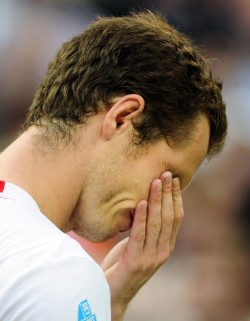 Andy Murray in tears at Wimbledon last Sunday, shortly after he'd been given the news about Norman Giller's book collection