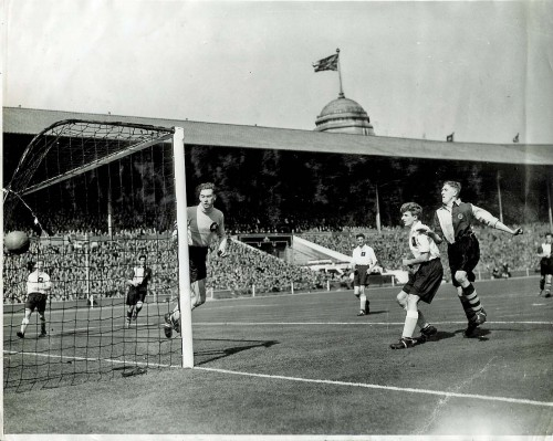 Ken Shearwood (second from the right, white shirt) watches the ball go past the Pegasus goalpost during the 1951 FA Amateur Cup Final against Bishop Auckland at Wembley before a capacity crowd of 100,000