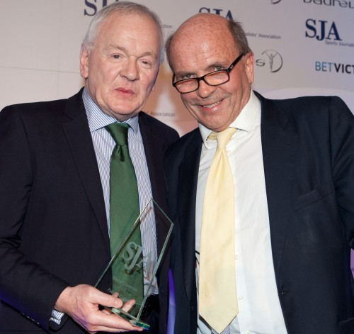 Patrick Collins receives the Sports Columnist of the Year award for a record-breaking fifth time in 2012 from Roger Alton (right)