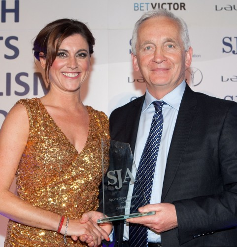 David Walsh collects one of his 2012 SJA prizes, in this case from Sky Sports News's Orla Chennouai