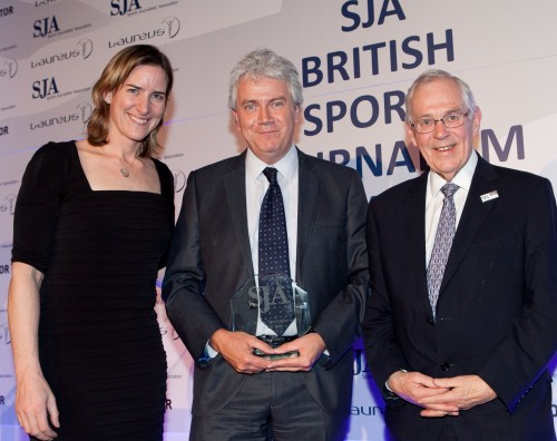 Well Times'd: Tim Hallissey, sports editor at The Times, accepts the Sports Newspaper of the Year trophy from Grianger and SJA chairman Barry Newcombe