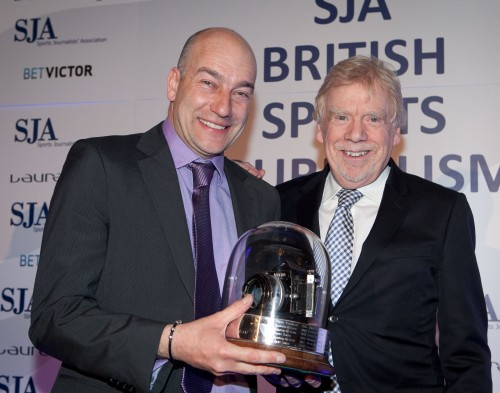 Adrian Dennis receives the Sports Photographer of the Year Trophy at our highly successful Sports Journalism Awards from Brendan Monks, one of the judges
