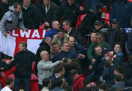 Flashpoint: Millwall fans fighting among themselves at Wembley yesterday