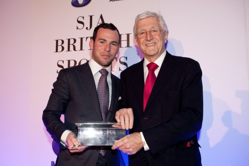 The SJA's 2011 Sportsman of the Year, cyclist Mark Cavendish, is presented with his award by the SJA President Sir Michael Parkinson