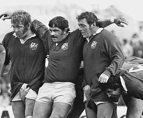 Up for a ruck: possibly the most famous front row in rugby history, Graham Price, left, with his club, country and Lions team mates Bobby Windsor and Terry Faulkner, on tour in 1977