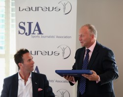 David Walker, the SJA chairman, presents guest Michael Vaughan with a Neville Cardus first edition at our Laureus-sponsored brunch. Photo by Andrew Redington/Getty Images