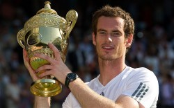 Murray's minted moment: a day which Norman Giller long wondered whether he would ever see a British-born male tennis player lift the Wimbledon trophy as Andy Murray did in July