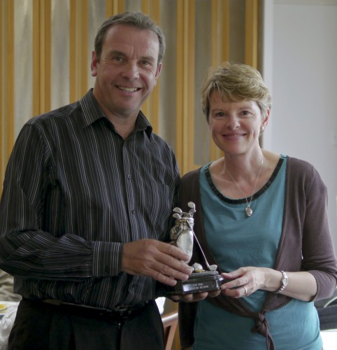 Champion performance: Gerry Cox receives the Phil Sheldon Trophy from Gill Sheldon at Muswell Hill GC on Monday. Photograph by Patrick Eagar