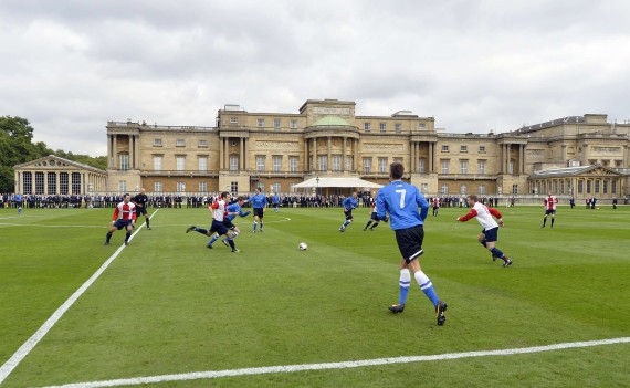 Nice grandstand: this week's special football match, staged in Her Maj's back garden. Photo by Toby Melville/Getty Images