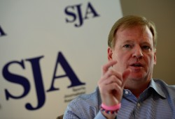NFL Commissioner Roger Goodell talks to members of the Sports Journalists' Association during a SJA Media Lunch in  October 2013