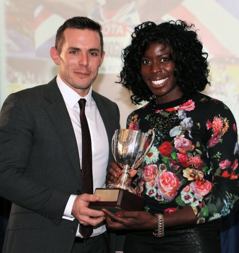 BBC broadcaster Kris Temple presents Christine Ohuruogu with her BAWA woman athlete of the year trophy