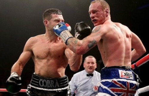 Who's the winner? George Groves, right, was stopped abruptly by the referee during his title fight with Carl Froch at the weekend