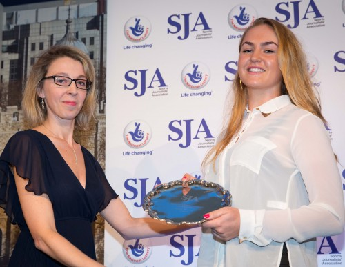 Charley Hull, right, who made her debut in Europe's senior Solheim Cup-winning team at the age of just 16, receives the SJA's Best International Newcomer trophy from Virginie Bernon, of Laureus