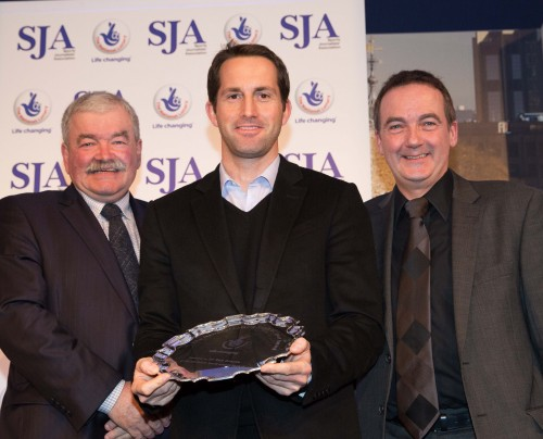 Rod Carr, left, from UK Sport, and Andy Duncan, of The National Lottery, with the winner of the Spirit of Sport Award, Sir Ben Ainslie, centre