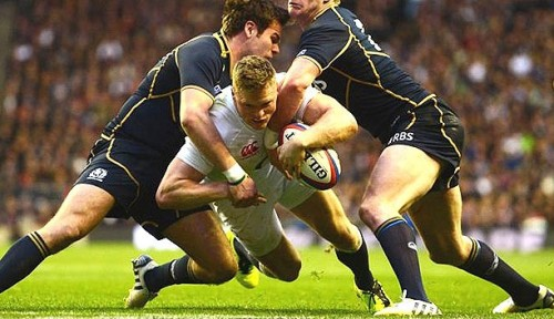 Wing Chris Ashton scores a try in England's Calcutta Cup win over Scotland in February 2013