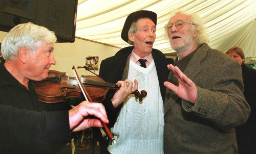 A chorus of approval: Munster fan Richard Harris and his mate Peter O'Toole serenade others in hospitality at the 2000 Heineken Cup final
