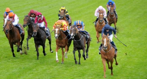 Ruler of the World, right in the dark blue colours, wins the Epsom Derby for trainer Aidan O'Brien