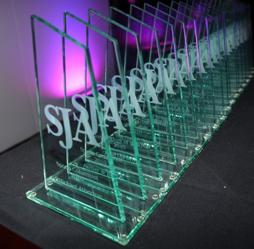 Whose names will be on the SJA trophies when they come to be presented on March 24?