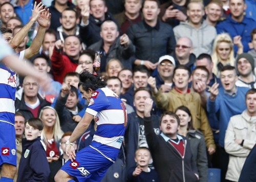 A bottle of Coke hits QPRs Joey Barton on the head. Picture by Andrew Boyers/Action Images