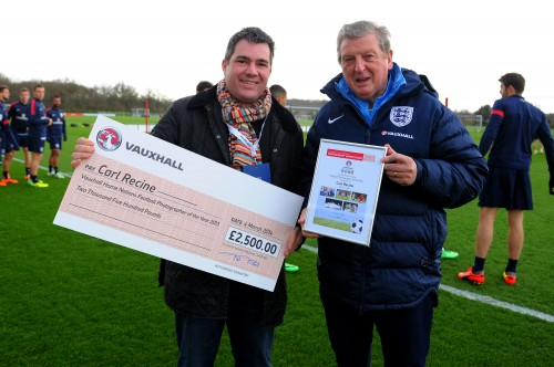 SJA member Carl Recine receives his Vauxhall prize from England manager Roy Hodgson