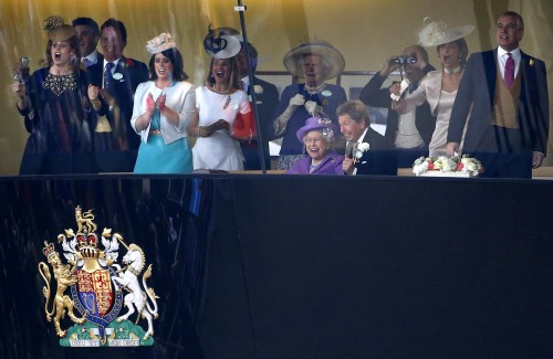 Queen Elizabeth reacts with members of her family and her racing team as she watches her horse Estimate win The Gold Cup during Ladies Day at Royal Ascot. It was the first time the race was won by a reigning monarch. Photo by Darren Staples/Reuters