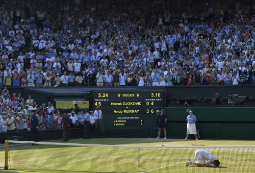 Toby Melville's winning Sports News Picture of the Year captured the moment when Andy Murray finally fulfilled his sporting destiny to win Wimbledon