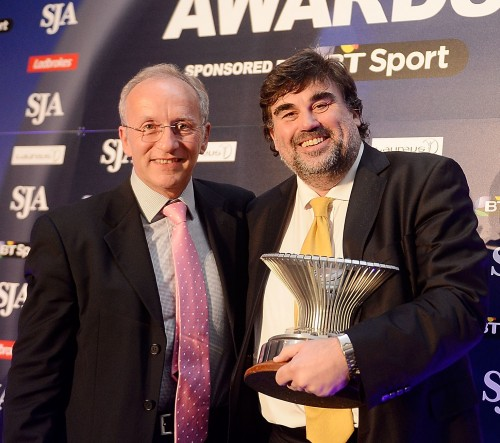 Martin Samuel receives the Sportswriter of the Year trophy for a fifth time from SJA chairman David Walker at our British Sports Journalism Awards. Picture by Bethany Clarke/Getty Images