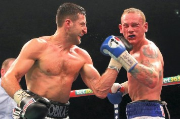 Froching punch: Carl Froch delivers the winning blow against gallant George Groves on Saturday