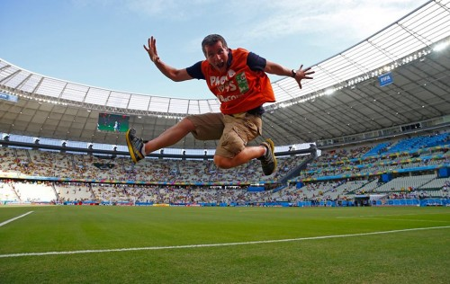 Thomson Reuters photographer Eddie Keogh celebrates not having anyone trying to steal his camera kit at the World Cup