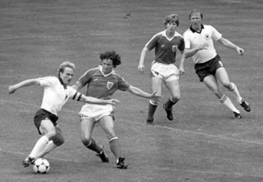 Karl-Heinz Rummenigge avoids a defenders challenge in the Game of Shame at the 1982 World Cup