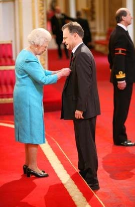 The Queen presents Mike Ingham with his MBE