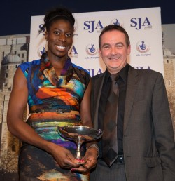 The SJA's 2013 Sportswoman of the Year, Christine Ohuruogu, receives her trophy from The National Lottery chief executive, Andy Duncan