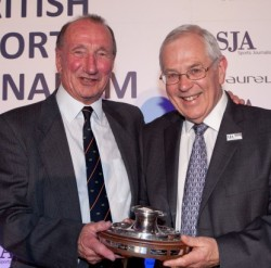 John Samuel, left, receiving the SJA's highest honour, the Doug Gardner Award for services to sports journalism, from Barry Newcombe in 2012