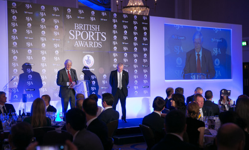 SJA President Sir Michael Parkinson, with host Jim Rosenthal on stage, welcomes guests to the Awards, where £1,500 was raised for his nominated charity, Prostate Cancer research