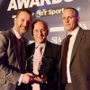On the move: Les Snowdon, right, with Mail head of sport Lee Clayton, receives the SJA's Sport Newspaper of the Year award from David Walker (centre) last March