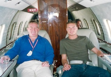 "For Bob McKenzie, the ""commute"" to work has sometimes involved taking a lift in a F1 driver's private plane, as here with David Coulthard"