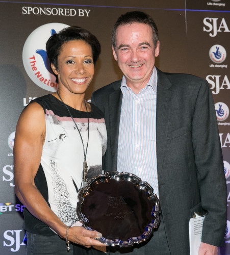 Kelly Holmes receives her Spirit of Sport Award from Andy Duncan of The National Lottery