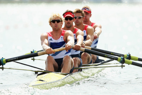 On his way to victory: Trigss Hodge stroking the GB coxless four to another wor