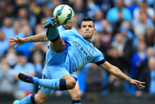 18th October 2014 - Barclays Premier League - Manchester City v Tottenham Hotspur - Sergio Aguero of Man City tries an acrobatic shot - Photo: Simon Stacpoole / Offside.