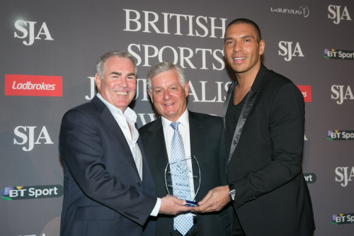 Sir Nicholas Lloyd, centre, presents TalkSport's Mark Saggers (left) and Stan Collymore with their prize for winning the Best Radio Documentary category