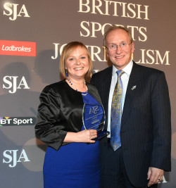 Ellie Oldroyd receives her Broadcast Presenter Award from SJA Chairman David Walker
