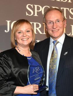 The BBC's Ellie Oldroyd receives her Broadcast Presenter Award from SJA Chairman David Walker