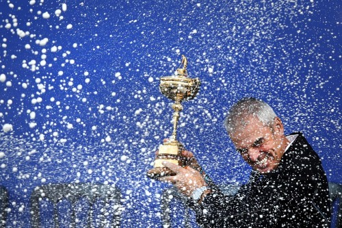 Adrian Dennis's sports portfolio, including this shot of Paul McGinlay lifting the Ryder Cup, secured him the title of Sports Photographer of the Year